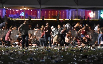 LAS VEGAS, NV - OCTOBER 01 People run from the Route 91 Harvest country music festival after apparent gun fire was heard on October 1, 2017 in Las Vegas, Nevada. There are reports of an active shooter around the Mandalay Bay Resort and Casino.   David Becker/Getty Images/AFP