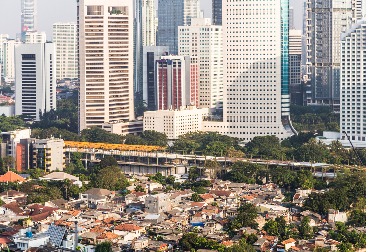 Middle to low class residential district contrasts with the modern skyscrapers of the business district of Jakarta in Indonesia capital city.